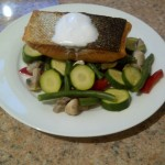 Pan fried salmon fillet in coconut oil with mixed veggies topped with coconut cream