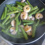 Prawns and asparagus cooked in coconut oil